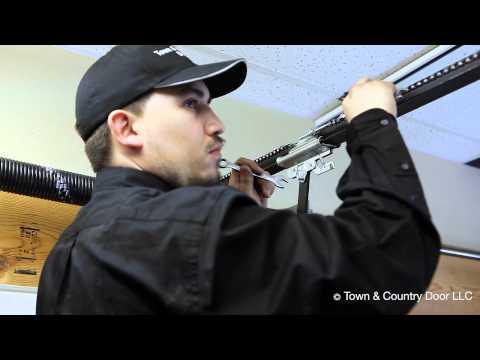 How to Adjust the Chain Tension of Garage Door Opener | Town & Country Door LLC
