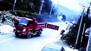 Family on scooter taken out by lorry trailer door
