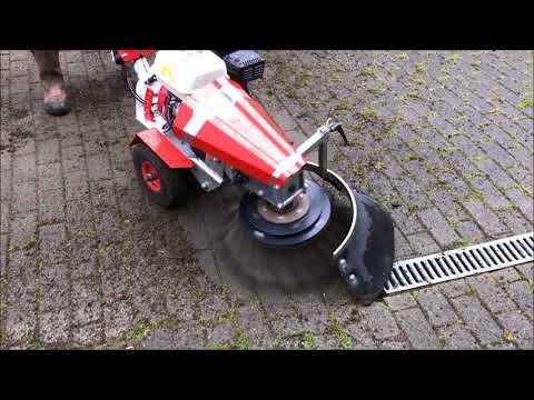 Nimos Weedripper Cleaning Moss & Weeds from Block Paving