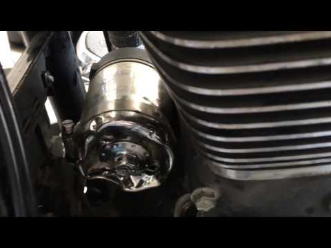 How to remove a stuck oil filter on a motorcycle