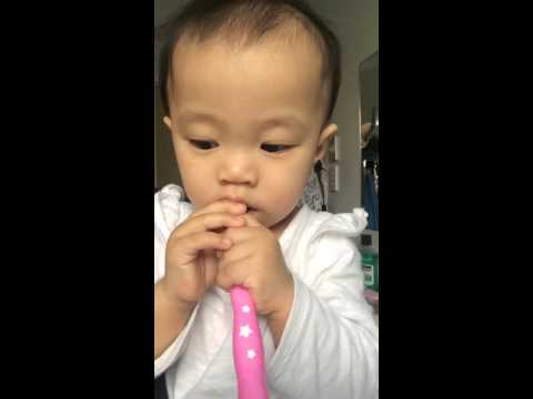 Tyra brushing her teeth for the first time at 9 months
