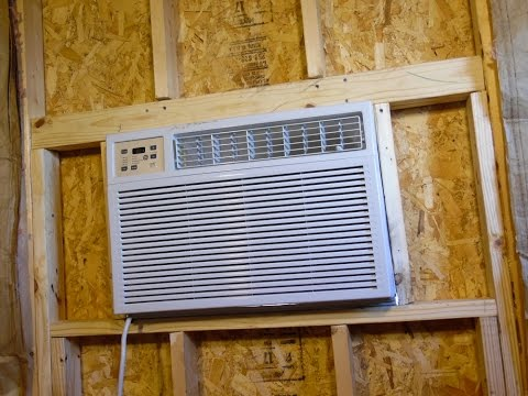 Our Tiny House Adventure: Installing the A/C into the wall.