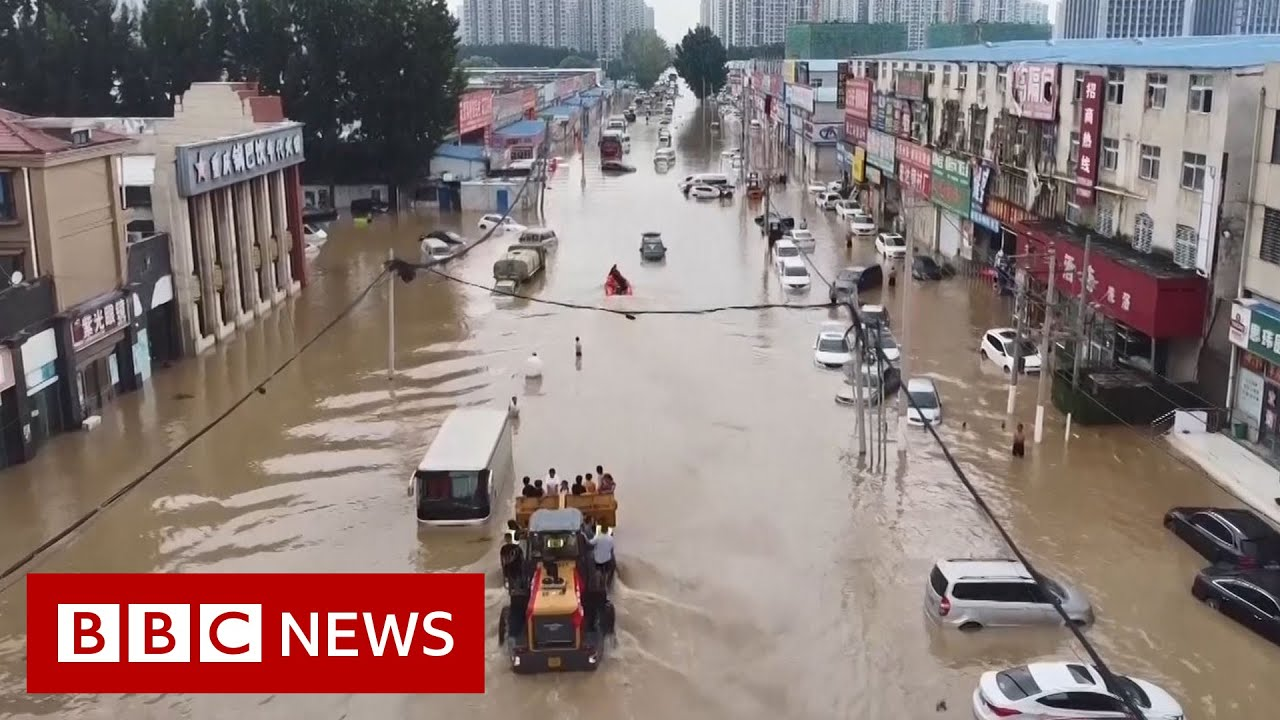 Drone video shows scale of China floods damage - BBC News