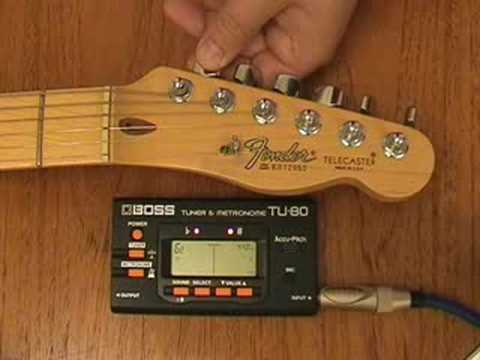 How to use an electronic guitar tuner to tune your guitar.