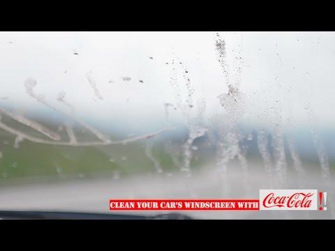 A perfect car's windscreen clean using a Coca Cola