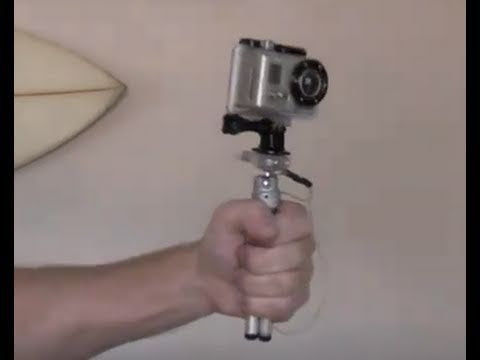 How do you hold your GoPro camera while filming?