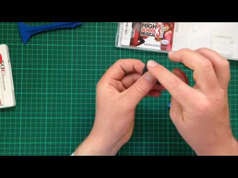 Opening a 3DS and DS Game Cartridge.