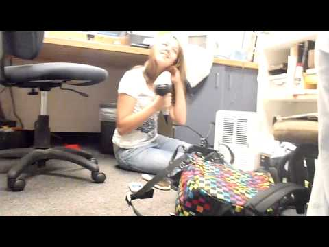 Sara blow drying her hair at school