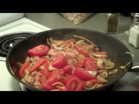 Chicken with red pepper, onions, tomatoes and noodles