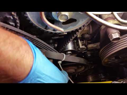 Getting the Bolts Out of Your Water Pump Pulley Mazda Progete5. (Timing Belt Install Tip)