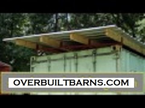 Shipping container roof over with steel trusses.