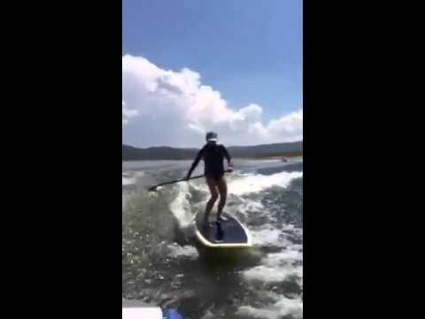 SUP surfing w/ 7' Door board behind the boat