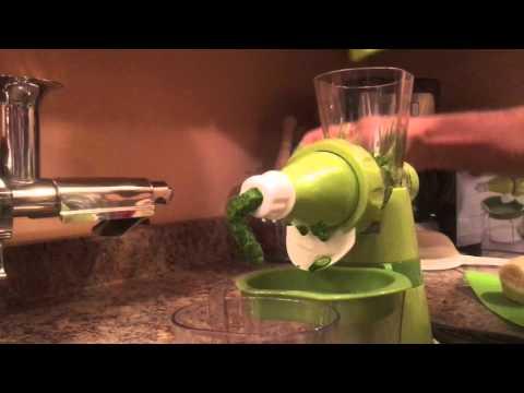 Making wheatgrass juice with manual juicer