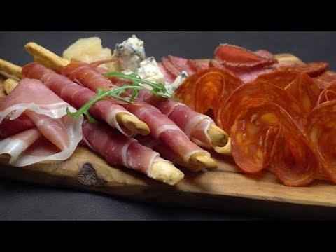 Video of Italian Meat Plate - Sliced Prosciutto, Sausage, Grissini and Parmesan | Stock Footage