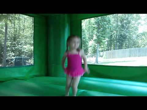 Amelia and Claire test the Jurassic Bouncy House