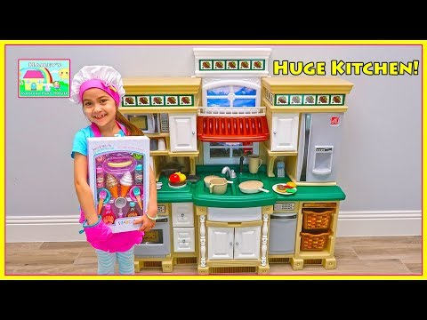 Hailey Pretend Play with Deluxe Kitchen Set & Gets Tummy Ache   Kids Videos