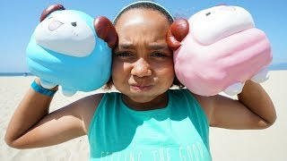 Download GIANT SQUISHY TOYS ON THE BEACH!! Video