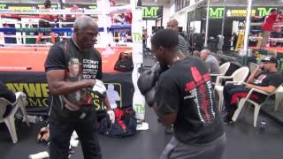 Floyd Mayweather Sr. padwork with his son Justin Mayweather