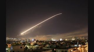 Raw: Flares Launched into Skies Above Damascus