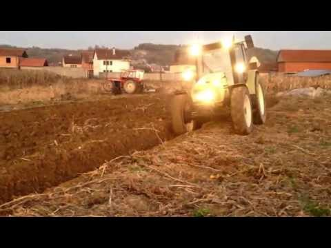 Plowing with tractor Hurlimann XT-909