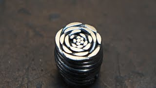 """Damascus steel """"Dinosaur Skin"""", from a plumbing cable."""