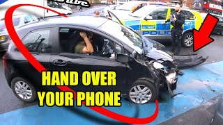 Driver Hands Phone To Police After Crash