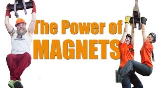 Huge super magnet lifting two people - The Power of Magnets - supermagnete