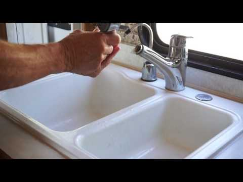 Repair of clogged Grohe Eurodisc faucet head.