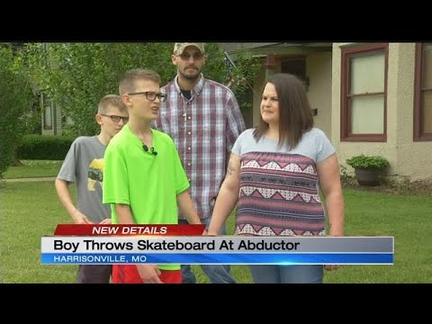 Boy fends off would-be kidnapper with skateboard