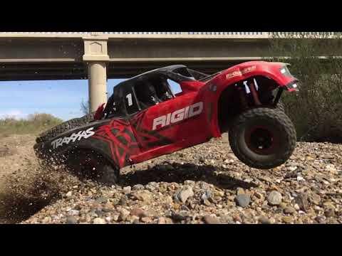 Traxxas Unlimited Desert Racer Bashing at the river/dirt bike jumps