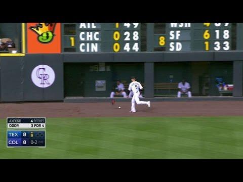 Gonzalez throws glove at Odor's foul ball
