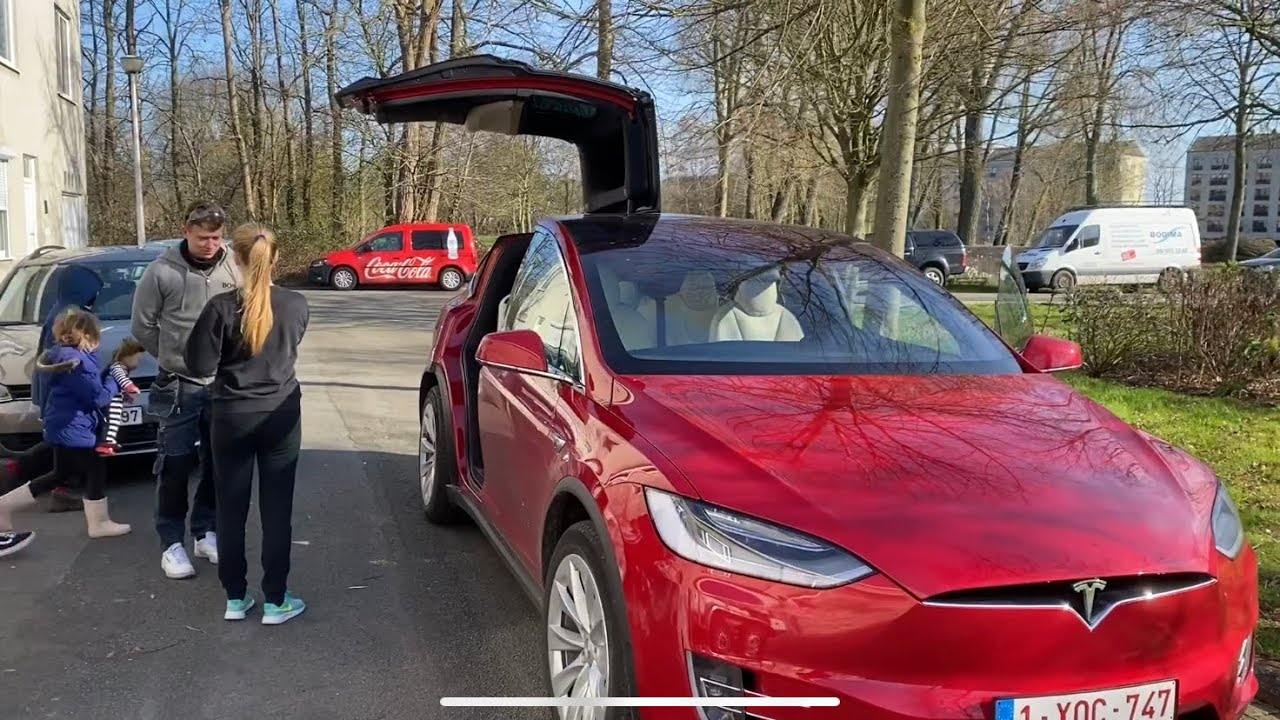 Presenting my red Tesla model X to my family
