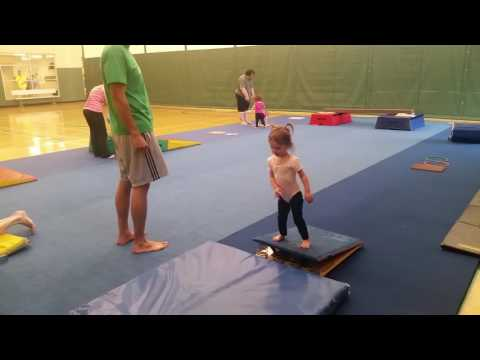 Monica as a gymnast toddler faceplant