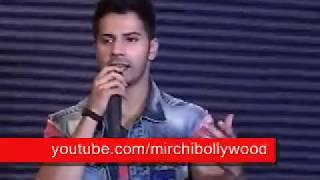 Varun Dhawan kissing Yami Gautam on stage during Badlapur promotion