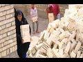 حلقة كاملة امراة عراقية تشتغل عماله في درجة حرارة 52 وتحمل الطابوق حتى تعين اطفالها علي عذاب