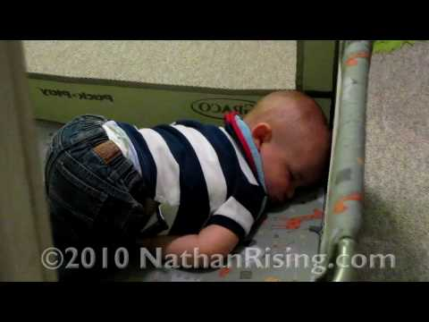 Toddler asleep and snoring in playpen