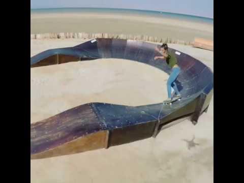 Girl Rides Skateboard on Pump Track