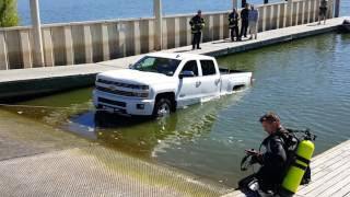 Brand new Silverado in water at, ramp total loss