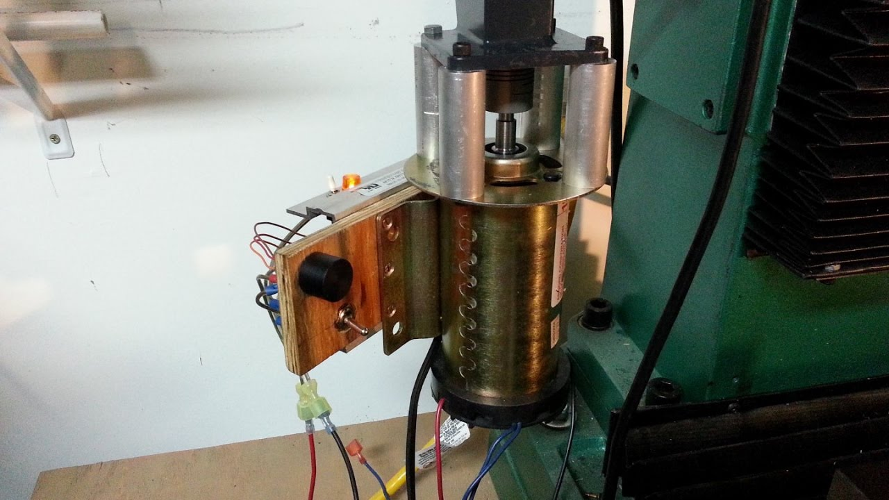 I built a Z-Axis motor for the Grizzly G0761 (RF45) milling machine from free treadmill parts.