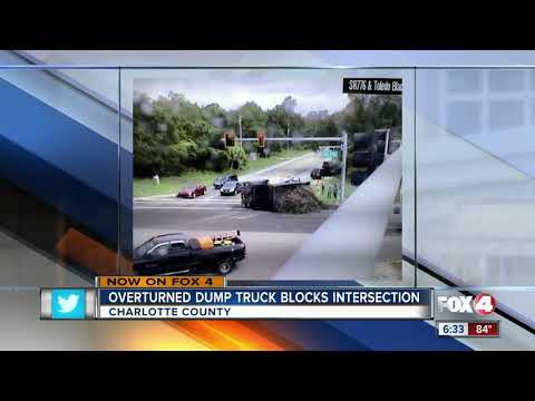 Truck overturns in intersection