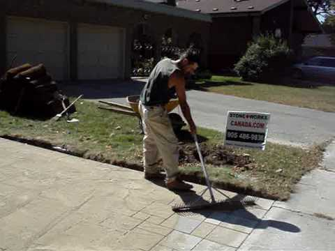 Polymeric sand installation for interlock stone driveway costruction
