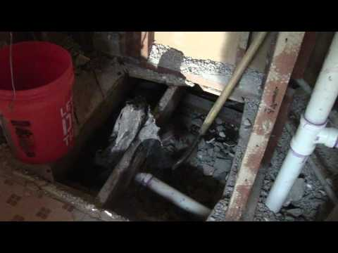 cleaning up old tile under a house from breaking up a shower pan