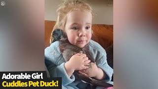 Adorable footage of a young girl cuddling her pet duck