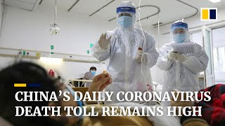 China's daily coronavirus death toll remains high but infections dip