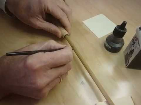 Inscribing a bamboo fly rod by Dave Dozer