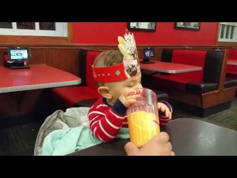 Infant Enjoys Trying to Steal a Friendly's Fribble