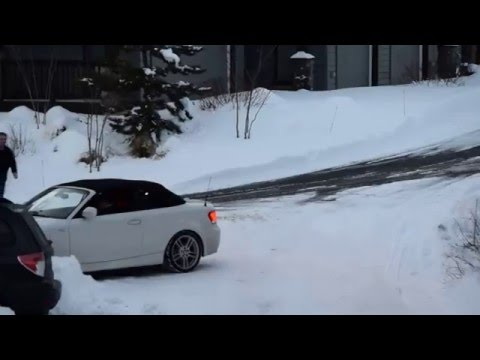 Rear wheel drive BMW Convertible in the snow