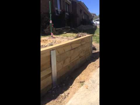 How to build a RETAINING WALL CONSTRUCTION TREATED PINE SLEEPERS C & H CHANNEL AGI PIPE