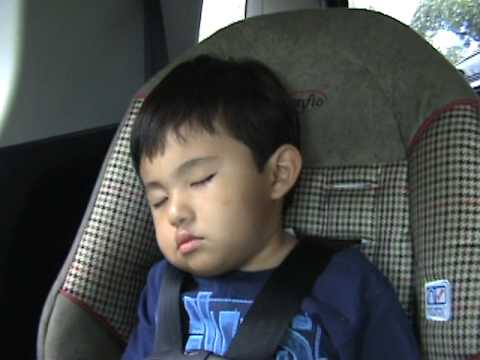 child sleeping in car seat with his head bobbing / slumping.