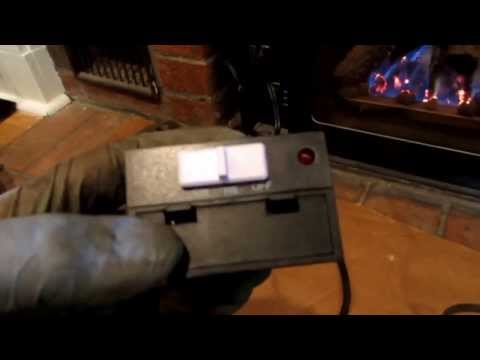 NATURAL GAS FIRE PLACE INSERT INSTALLED ,WITH THREADED BLACK GAS PIPE
